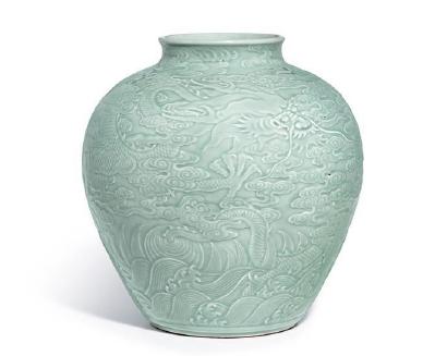 A Magnificent Carved Celadon-Glazed 'Dragon' Jar