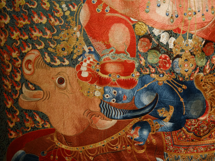 A HIGHLY IMPORTANT IMPERIAL EMBROIDERED SILK THANGKA