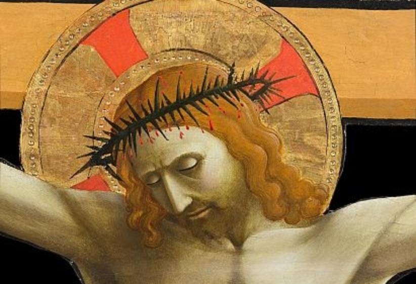 Particolare del volto del cristo restaurato