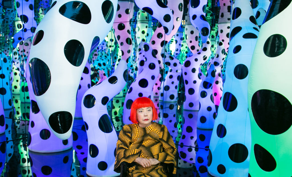 "Yayoi Kusama with her work LOVE IS CALLING during her solo exhibition ""I Who Have Arrived In Heaven"" at David Zwirner in New York in 2013. ©YAYOI KUSAMA/COURTESY DAVID ZWIRNER, NEW YORK; OTA FINE ARTS, TOKYO, SINGAPORE, AND SHANGHAI; AND VICTORIA MIRO, LONDON AND VENICE"