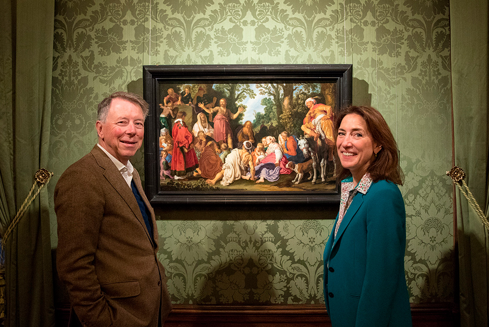 Ben van Doesburgh and Emilie Gordenker pose with Pieter Lastman's St John the Baptist Preaching.