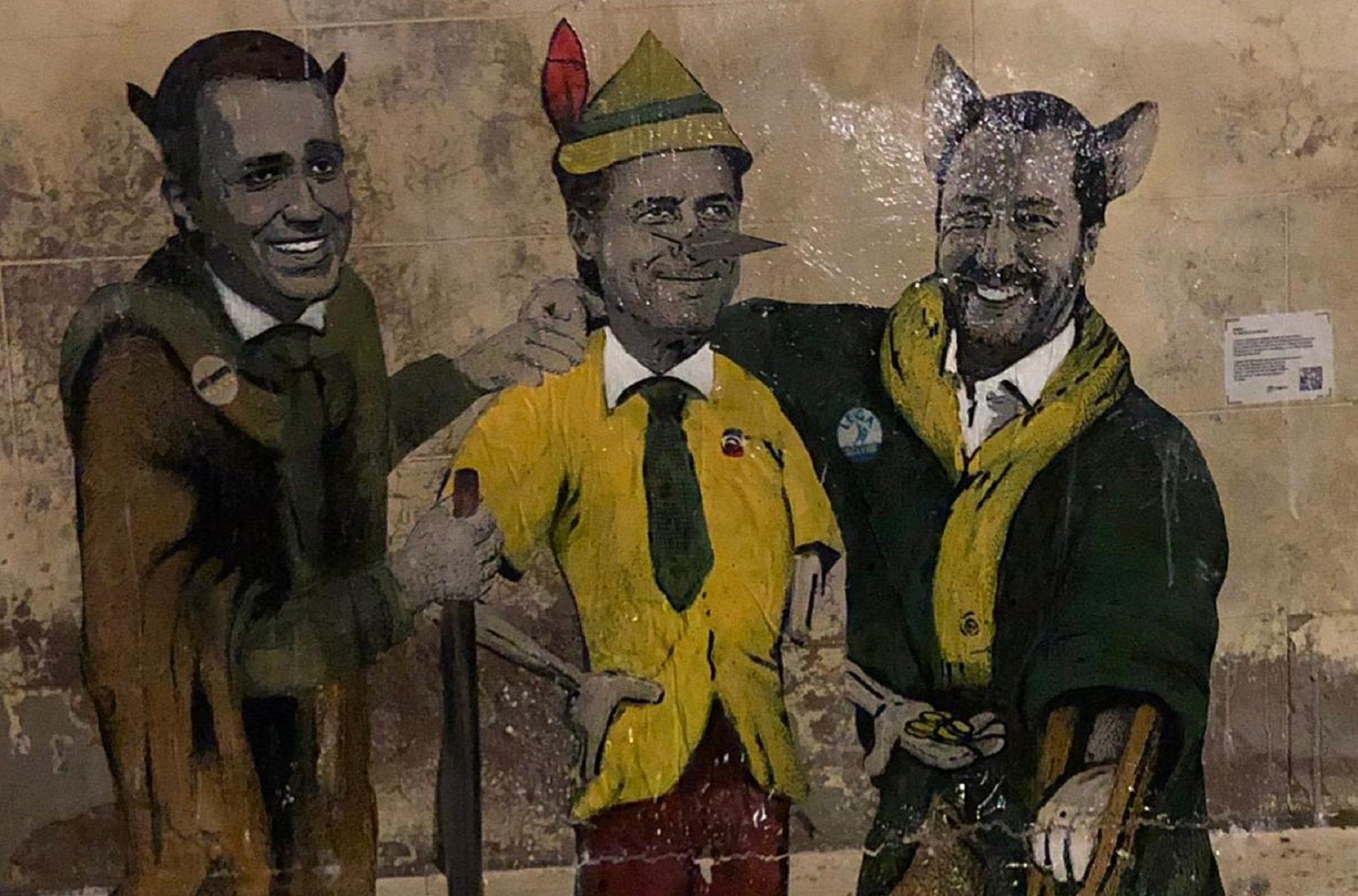 Nuova provocazione di Tv Boy: Salvini e Di Maio come il gatto e la volpe, Conte nel paese dei balocchi