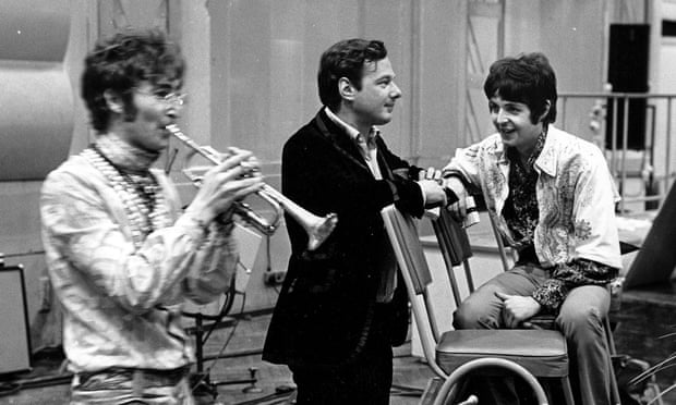 Brian Epstein, centre, with John Lennon and Paul McCartney at Abbey Road studios. Photograph: David Magnus/Rex/Shutterstock