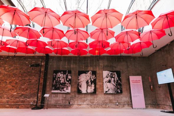 Sun Kim's red umbrella installation at Sex Worker Pop-Up. Photo by Jonna Algarin Mojica courtesy of Sex Worker Pop-Up.