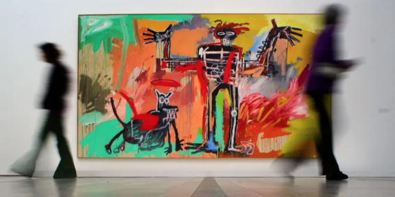 """Jean-Michel Basquiat, """"Boy and Dog in a Johnnypump"""", goto FABRICE COFFRINI-AFP Via Getty Images"""