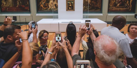 Mona Lisa being besieged by hundreds of Tourists just waiting for 60 seconds of time in front of this picture. Paris Picdump #3 Louvre Ph. Mika Baumeister