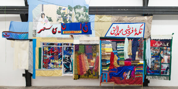 Hangama Amiri, Bazaar, 2020, cotton, chiffon, muslin, silk, suede, digitally woven textile, camouflage fabric, sari textile, inkjet prints on paper and canvaspaper, plastic, acrylic paint, marker, polyester, table cloth, faux leather and found fabrics, 427 × 793 cm - Courtesy T293 Roma, ph. Roberto Apa