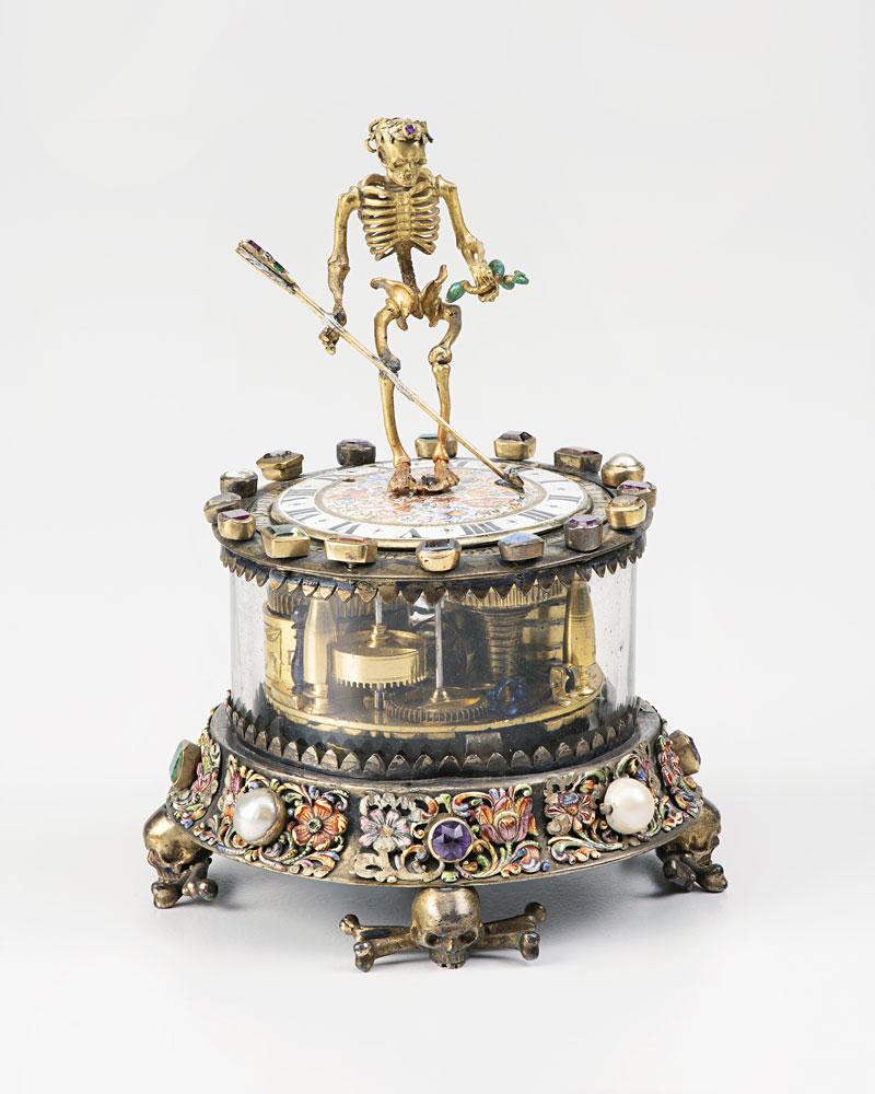 Christian Giessenbeck (Augusta, att. 1640 - 1660), Orologio con scheletro, 1640–1660, oro, smalti e pietre preziose, h. 10 cm, Zurigo, Museo Nazionale Svizzero
