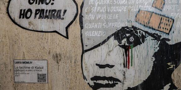 Murale omaggio a Gino Strada in Afghanistan bambino con benda