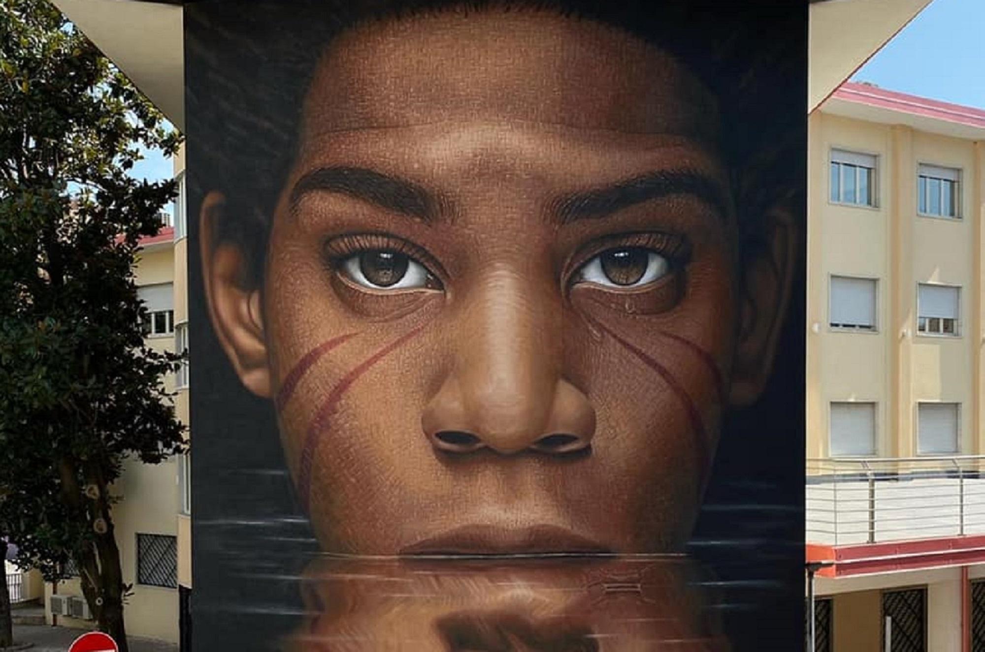 Jorit a Diamante. Il suo intenso Basquiat con le cicatrici della Human Tribe